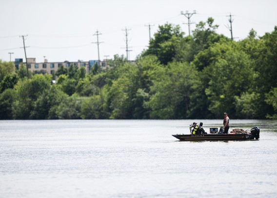 Washtenaw County Sheriff members and dive team search Huron River for the body of 21-year-old Pittsfield Township man on Sunday, June 30. Daniel Brenner I AnnArbor.com
